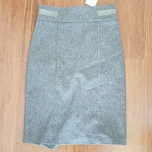 New with tag Bebe skirt with back kick green tweed
